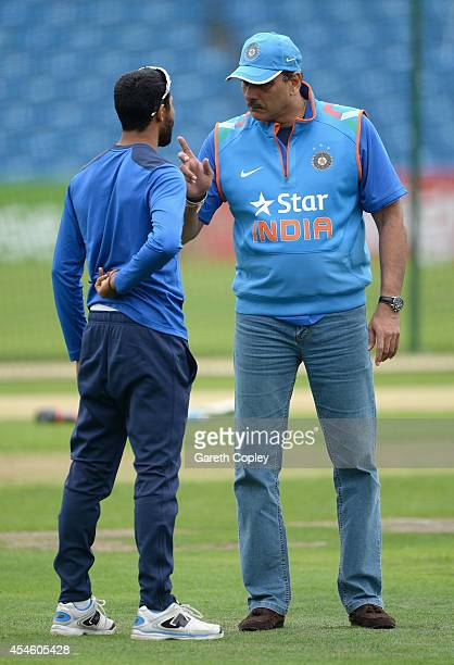 India Director of Cricket Ravi Shastri speaks with Ravindra Jadeja during a nets session at Headingley on September 4 2014 in Leeds England