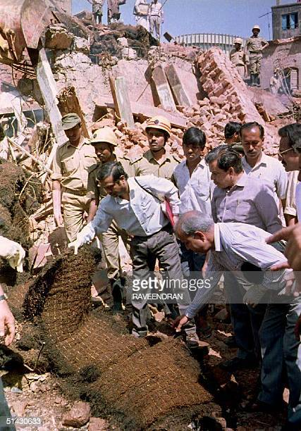 India Explosive experts flown in from Bombay collect specimens 18 March 1993 to establish the cause of the massive blast that destroyed a fourstory...