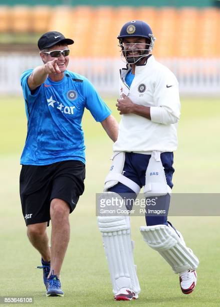 India fielding coach Trevor Penney and Shikhar Dhawan minic the rest of the teams warm up during a training session at Grace Road Leicester