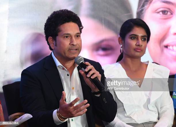 India former cricketer and UNICEF Goodwill Ambassador Sachin Tendulkar speaks as Indian women's cricket team captain Mithali Raj listens during a...