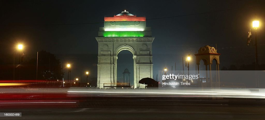 India gate illuminated in Tricolors of Indian flag after the Beating Retreat ceremony on January 29, 2013 in New Delhi, India. The Beating Retreat ceremony officially marks the end of Republic Day celebrations.