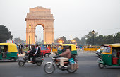 India Gate overlooking busy city street, Delhi, India