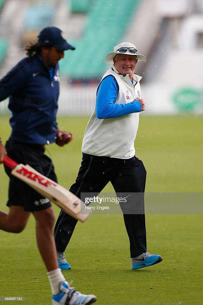 India head coach <a gi-track='captionPersonalityLinkClicked' href=/galleries/search?phrase=Duncan+Fletcher&family=editorial&specificpeople=202105 ng-click='$event.stopPropagation()'>Duncan Fletcher</a> runs off the field as rain halts practice during an India Nets Session at The Kia Oval on August 14, 2014 in London, England.