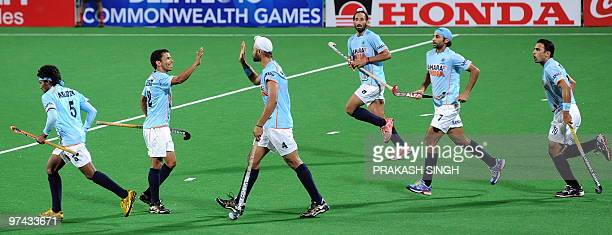India hockey player Sandeep Singh celebrates a goal against Spain with teammates during their World Cup 2010 match at the Major Dhyan Chand Stadium...