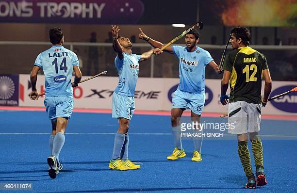 India hockey players Lalit Upadhyay and Uttapa Sannuvanda celebrate a goal against Pakistan during their Hero Hockey Champions Trophy 2014 semi final...