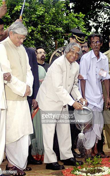 Indian state of West Bengal Governor Gopal Krishna Gandhi looks on as Indian President APJ Abdul Kalam plants a Bhringaraj medicinal plant in Kolkata...