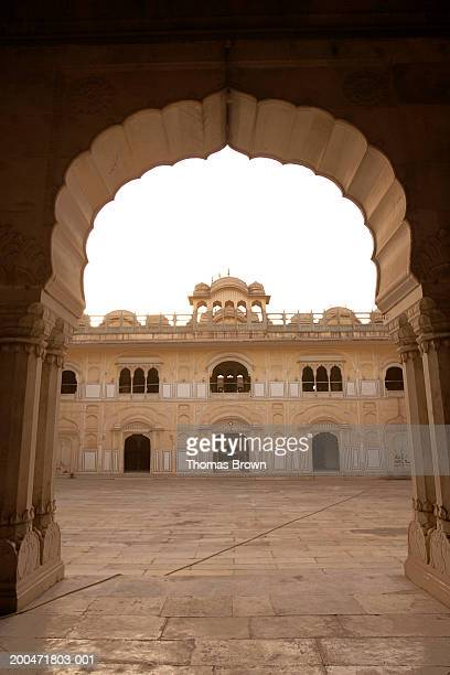 India, Jaipur, view of courtyard through archway