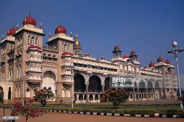 India Karnataka Mysore Mysore Palace also known as Amba Vilas Palace completed in 1912 in IndoSaracencic style Exterior with flowering bushes