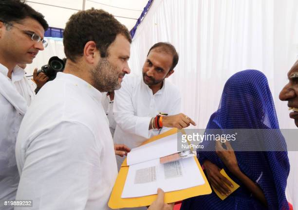 India main opposition Congress Party Vice President Rahul Gandhi meets with the family members of the farmers who committed suicide due to heavy...