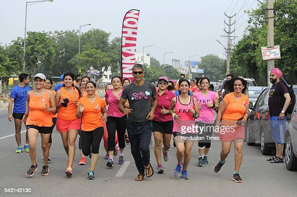 India modelactorrunner Milind Soman with more than 100 women participants takes part during a Pinkathon touted as India's biggest women's run on June...