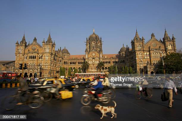 'India, Mumbai, Chhatrapati Shivaji Terminus, pedestrians in foreground'