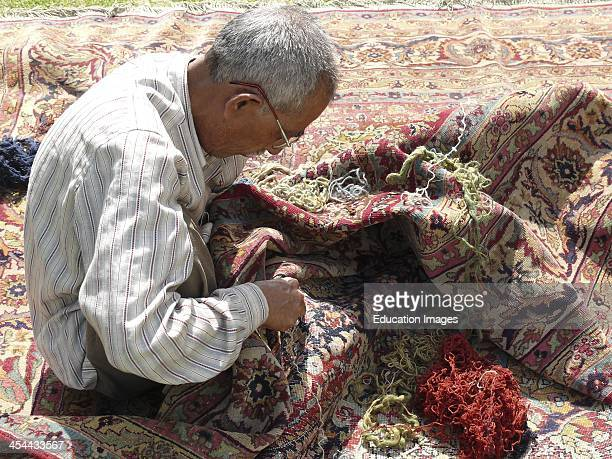 India New Delhi Kashmiri Craftsman Who Visits Homes To Repair Old Kasmiri Carpets