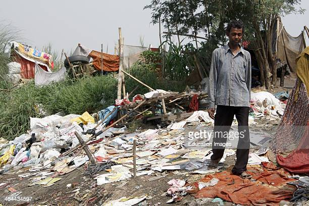 India New Delhi River Yamuna Colony Of RagPickers Who Live On Island In Middle Of River And Fish Out Garbage For A Living