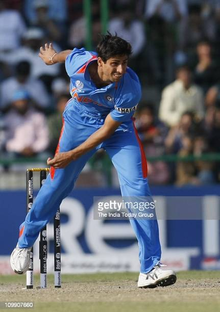 India paceman Ashish Nehra bowls during the World Cup Group B match at the Ferozeshah Kotla in New Delhi on Wednesday