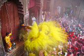 India, people in front of temple during Holi festival