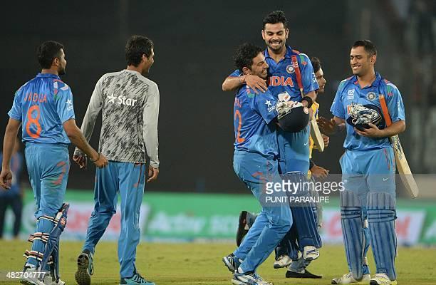 India player Yuvraj Singh picks up batsman Virat Kohli as captain Mahendra Singh Dhoni watches after India won the ICC World Twenty20 cricket...