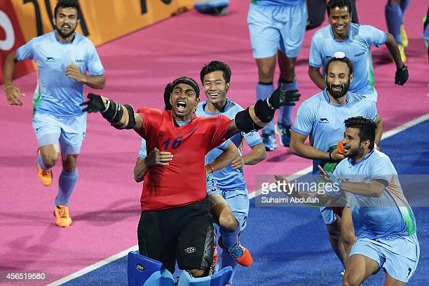 India players celebrate after defeating Pakistan during the men's hockey gold medal match on day thirteen of the 2014 Asian Games between India and...