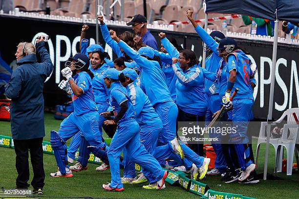 India players celebrate after winning the women's Twenty20 International match between Australia and India at Melbourne Cricket Ground on January 29...