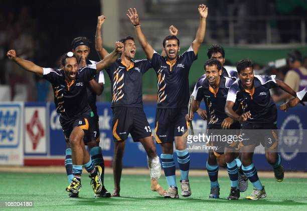 India players celebrate their teams success in the penalty shoot out during the semi final hockey match between India and England at Major Dhyan...