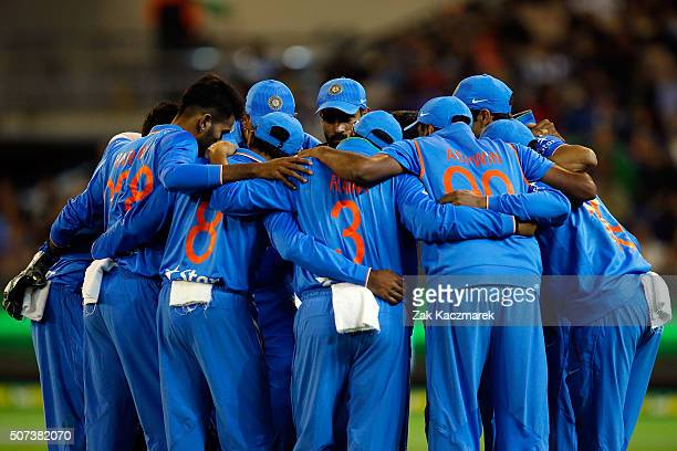 India players gather during the International Twenty20 match between Australia and India at Melbourne Cricket Ground on January 29 2016 in Melbourne...