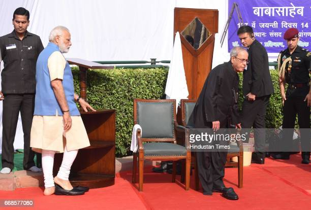India President Pranab Mukherjee and Prime minister Narendra Modi and others after paying floral tribute to Dr BR Ambedkar at Parliament House on...