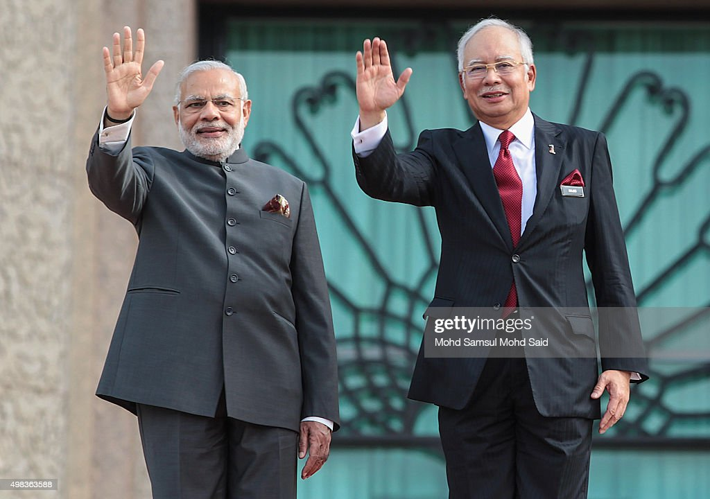 India Prime Minister <a gi-track='captionPersonalityLinkClicked' href=/galleries/search?phrase=Narendra+Modi&family=editorial&specificpeople=822611 ng-click='$event.stopPropagation()'>Narendra Modi</a> and Malaysia's Prime Minister Najib Razak wave to media outside the Malaysia's Prime Minister Najib Razak office during an official visit to Malaysia on November 23, 2015 in Putrajaya, Malaysia. Modi is on a three-day visit to Malaysia which includes bilateral talks between the two countries.