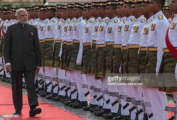 India Prime Minister Narendra Modi inspects a honour guard outside the Malaysia's Prime Minister Najib Razak office during an official visit to...