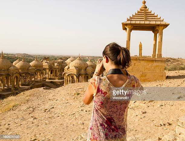 India, Rajasthan, Jaisalmer, Tourist at Bada Bagh Cenotaphs