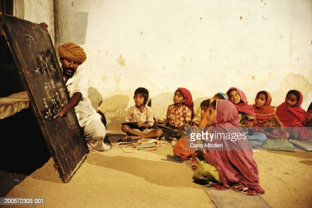 India Rajasthan Tilonia children in classroom with teacher