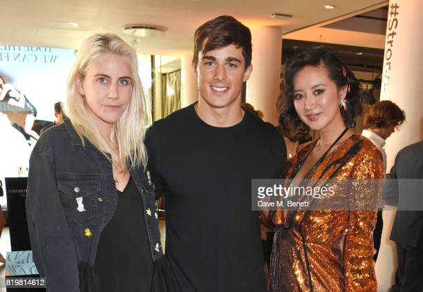India Rose James Pietro Boselli and Betty Bachz attend the Emporio Armani You Fragrance launch at Sea Containers on July 20 2017 in London England