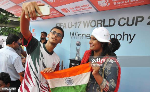 India Sports lovers hold Indian National Flag and his mobile camera Selfie at The FIFA U17 World Cup 2017 Winners Trophy visit in Kolkata City on...