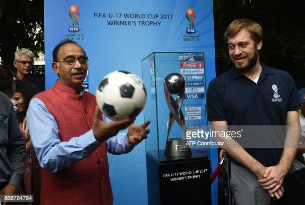 India Sports Minister Vijay Goel and FIFA U17 World Cup 2017 Tournament Director Javier Ceppi pose with the FIFA U17 World Cup 2017 trophy during a...