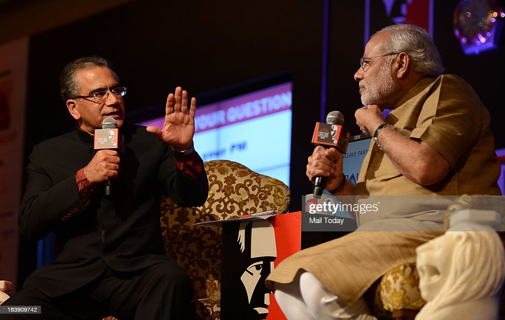India Today Group Chairman and Editor in Chief Aroon Purie with Gujarat chief minister Narendra Modi at the India Today Conclave 2013 in New Delhi.