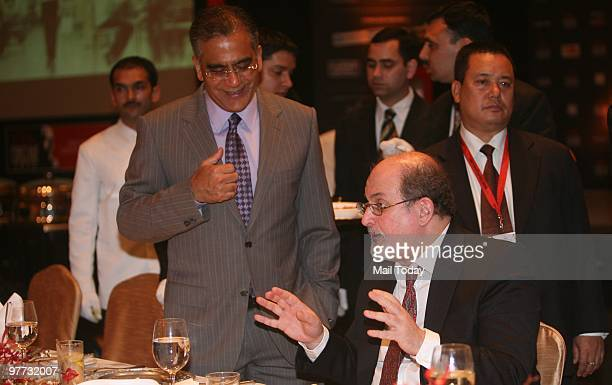 India Today group chairman Aroon Purie has a word with author Salman Rushdie at the dinner party hosted after the India Today Conclave ended in New...