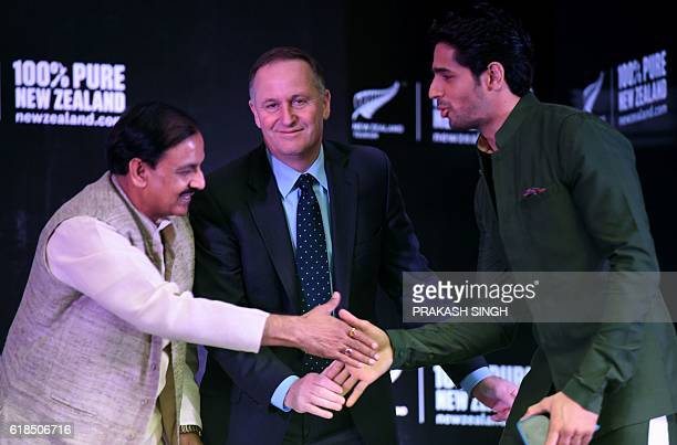 India Tourism and Cultural Minister Mahesh Sharma shakes hands with Indian actor and Tourism New Zealand Brand Ambassador Sidharth Malhotra as New...