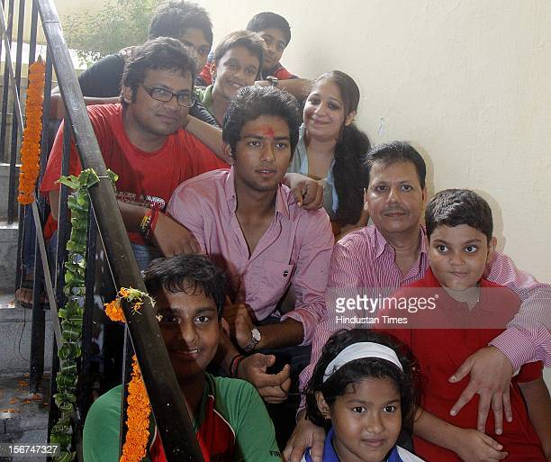 'NEW DELHI INDIA AUGUST 30 India U19 cricket captain Unmukt Chand with his friends at his Residence on August 30 2012 in New Delhi India Unmukt Chand...