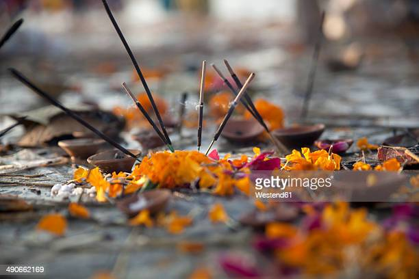 India, Uttar Pradesh, Allahabad, Kumbh Mela pilgrimage, Joss sticks and petals