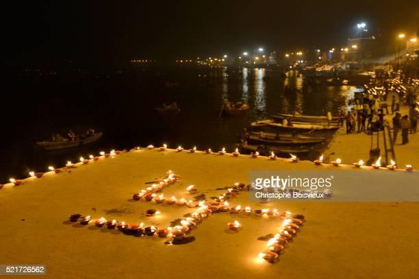 India, Uttar Pradesh, Varanasi, Swastika shaped earthen lamps lit for Dev Deepawali festival