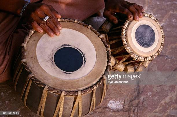 India Uttar Pradesh Vrindavan Cropped shot of tabla player