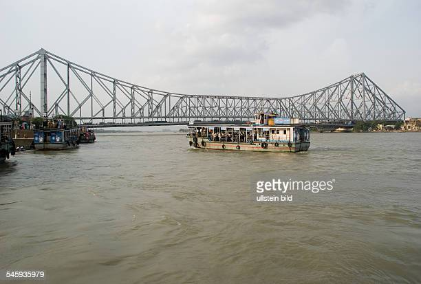 India West Bengal Kolkata Howrah Bridge and ferry service over river Hooghly 2010