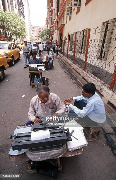 India West Bengal Kolkata street typist providing services with government forms for illiterate persons