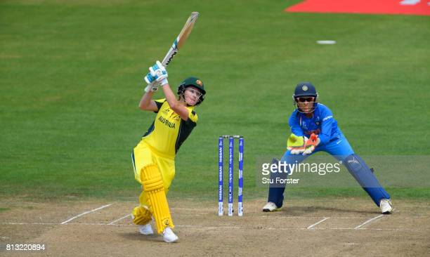 India wicketkeeper Sushma Verma looks on as Australia batsman Beth Mooney hits out during the ICC Women's World Cup 2017 match between Australia and...
