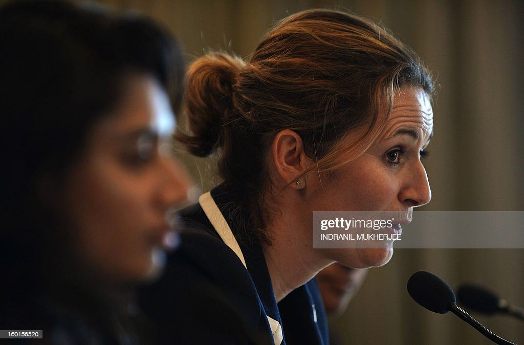 India Womens cricket team captain Mithali Raj (L) looks on as England captain Charlotte Edwards speaks during a press conference for the forthcoming ICC Women's World Cup 2013 in Mumbai on January 27, 2013. Teams from Australia, England, New Zealand, Pakistan, South Africa, Sri Lanka, West Indies join hosts India for the global event which is being played from January 31 to February 17. AFP PHOTO/Indranil MUKHERJEE