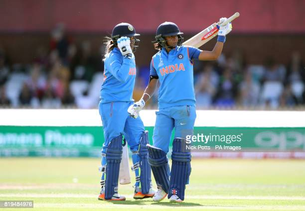 India Women's Harmanpreet Kaur celebrates reaching 150 with Veda Krishnamurthy during the ICC Women's World Cup Semi Final match at The County Ground...