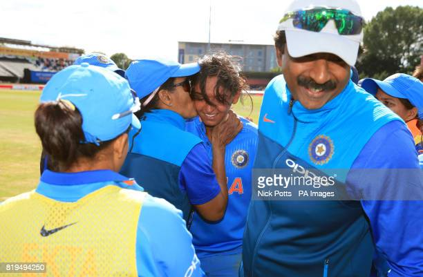 India Women's Harmanpreet Kaur is congratulated by teammates after an innings score of 171 not out during the ICC Women's World Cup Semi Final match...