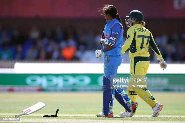 India Women's Harmanpreet Kaur reaches her century but throws her bat after a mixup running between the wickets with Deepti Sharma during the ICC...