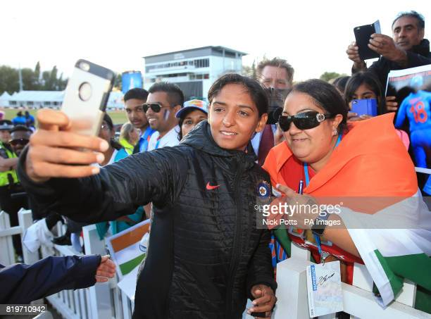 India Women's Harmanpreet Kaur takes a picture with a fan after victory in the ICC Women's World Cup Semi Final match at The County Ground Derby