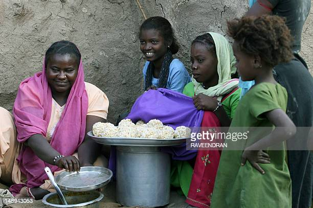 IndiaAfricatribecultureFEATURE by Elizabeth Roche Siddi tribal children gather around a food vendor in the village of Jambursome 480kms southwest of...