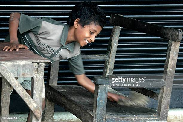 IndiachildlaboureconomylawFEATURE BY Tripti Lahiri Eleven year old Indian child Raju Prasad cleans surfaces at a roadside hotel in Janakinagar on...