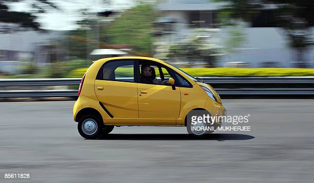 IndiacompanyautoTataNanoSCENE by Phil Hazlewood A foreign journalist test drives the newlyreleased Nano car at the Tata Motors plant at Pimpri some...